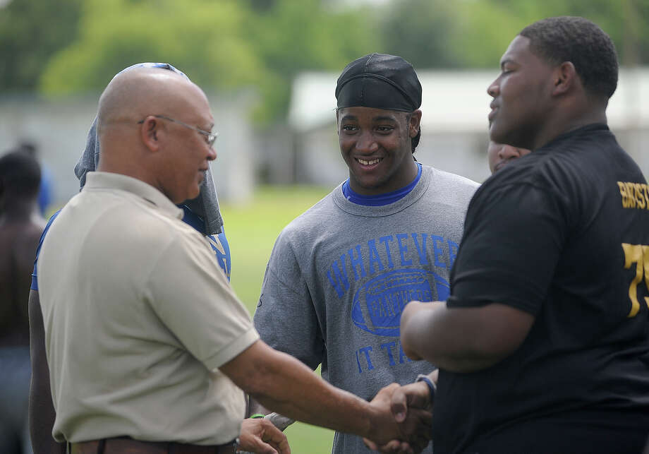 Ozen players shake hands with school principal James Broussard during the team's first practice in August 2011. Guiseppe Barranco/The Enterprise Photo: Guiseppe Barranco