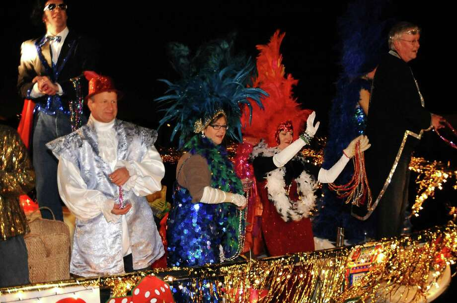 Festive parade participants toss beads from a boat during the Yachty Gras boat parade in 2010 in Kemah.Festive parade participants toss beads from a boat during the Yachty Gras boat parade in 2010 in Kemah. Photo: Kirk Sides