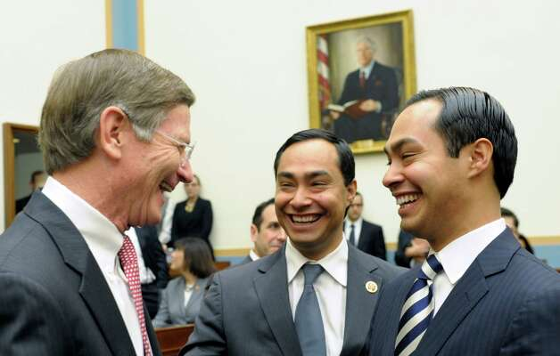 San Antonio, Texas Mayor Julian Castro, right, and his brother Rep. Joaquin Castro, D-Texas, center, talk with House Judiciary Committee member, Rep. Lamar Smith, R-Texas, all from San Antonio, on Capitol Hill in Washington, Tuesday, Feb. 5, 2013, prior to Mayor Castro testifying before the committee's hearing on America's Immigration System: Opportunities for Legal Immigration and Enforcement of Laws against Illegal Immigration.  (AP Photo/Susan Walsh) Photo: Susan Walsh, Associated Press / AP