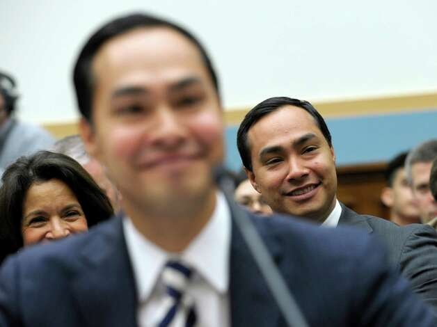 Rep. Joaquin Castro, D-Texas listens at right as his brother, San Antonio, Texas Mayor Julian Castro, left, testifies on Capitol Hill in Washington, Tuesday, Feb. 5, 2013, before the House Judiciary Committee hearing on America's Immigration System: Opportunities for Legal Immigration and Enforcement of Laws against Illegal Immigration.  (AP Photo/Susan Walsh) Photo: Susan Walsh, Associated Press / AP