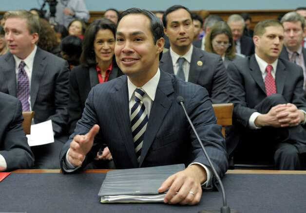 San Antonio, Texas Mayor Julian Castro, center, accompanied by his brother Rep. Joaquin Castro, D-Texas, second from right, gestures on Capitol Hill in Washington, Tuesday, Feb. 5, 2013, prior to testifying before the House Judiciary Committee hearing on America's Immigration System: Opportunities for Legal Immigration and Enforcement of Laws against Illegal Immigration.  (AP Photo/Susan Walsh) Photo: Susan Walsh, Associated Press / AP
