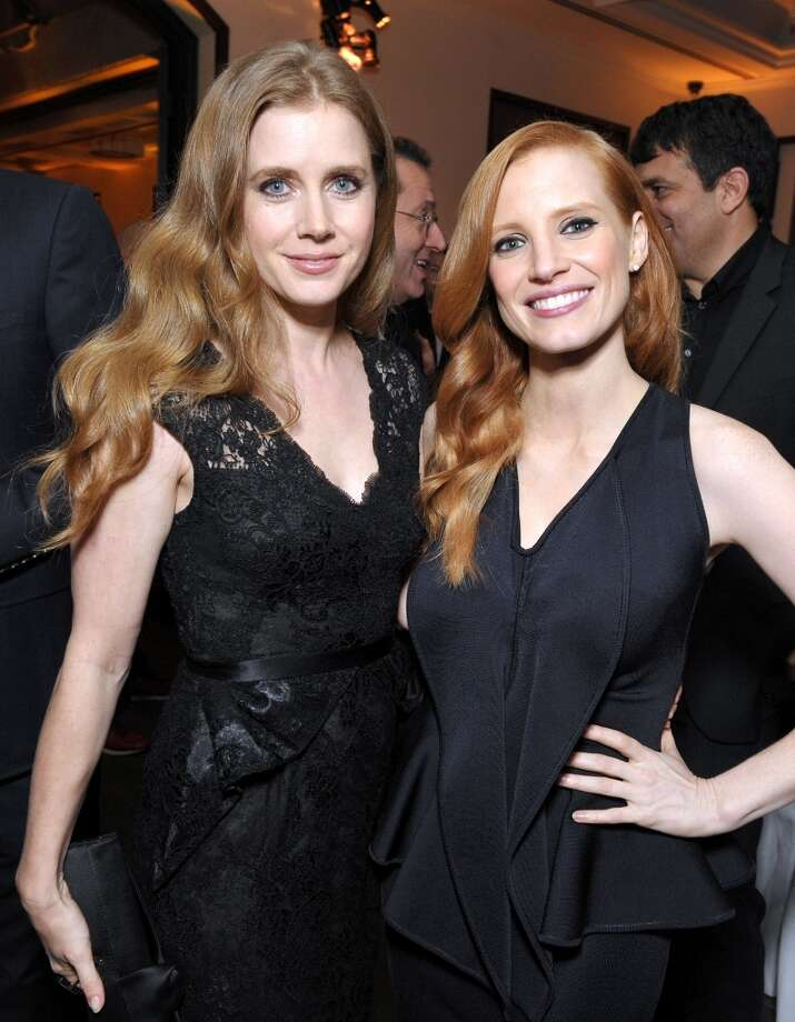 Amy Adams, left, and Jessica Chastain attend The Hollywood Reporter Nominees' Night at Spago on Monday, Feb. 4, 2013, in Beverly Hills, Calif. (Photo by John Shearer/Invision for The Hollywood Reporter/AP Images) Photo: John Shearer, Associated Press / Invision