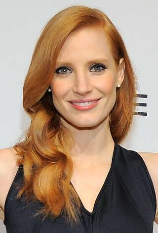 Jessica Chastain arrives at The Hollywood Reporter Nominees' Night at Spago on Monday, Feb. 4, 2013, in Beverly Hills, Calif. (Photo by Chris Pizzello/Invision for The Hollywood Reporter/AP Images) Photo: Chris Pizzello, Associated Press / Invision