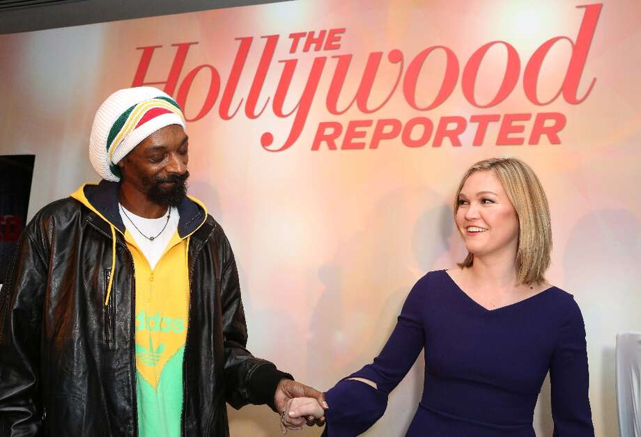 Snoop Dogg, AKA Snoop Lion, left, and Julia Stiles perform at The Hollywood Reporter Nominees' Night Insider at Spago on Monday, Feb. 4, 2013, in Beverly Hills, Calif. (Photo by Casey Rodgers/Invision for The Hollywood Reporter/AP Images) Photo: Casey Rodgers, Associated Press / Invision