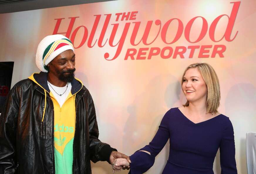 Snoop Dogg, AKA Snoop Lion, left, and Julia Stiles perform at The Hollywood Reporter Nominees' Night