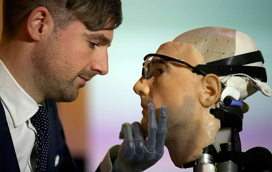 "The face is familiar: Researcher Bertolt Meyer, a lifelong user of prosthetic technology and the model for Rex, the world's first ""bionic man,"" considers his likeness at the Science Museum in London. Rex boasts prosthetic limbs and a functional circulatory system complete with artificial blood, as well as an artificial pancreas, kidney, spleen and trachea. Photo: Andrew Cowie, AFP/Getty Images"