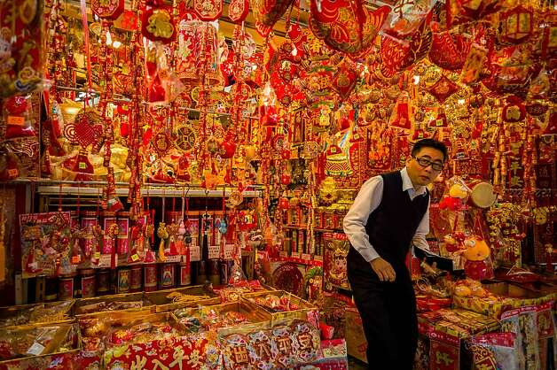 Hope you like red and gold: A shop in Hong Kong sells decorations for Chinese New Year on Sunday. Photo: Philippe Lopez, AFP/Getty Images