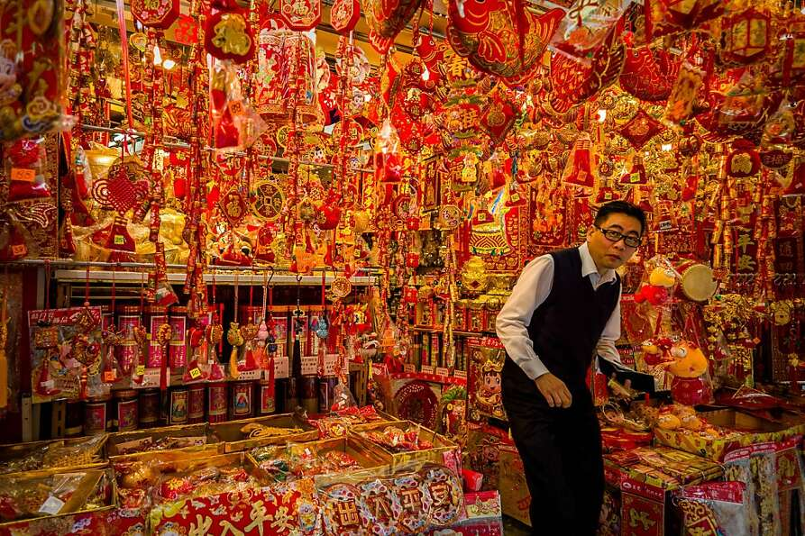 Hope you like red and gold: A shop in Hong Kong sells decorations for Chinese New Year on Sun