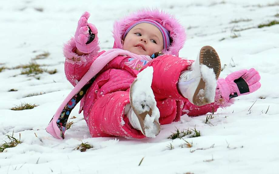 Just give her a push and watch her go: Having no sled or saucer is no problem for 3-year-old Jenna Broughton in Cannonsburg, Ky. - not with that slick snow suit. Photo: Kevin Goldy, Associated Press