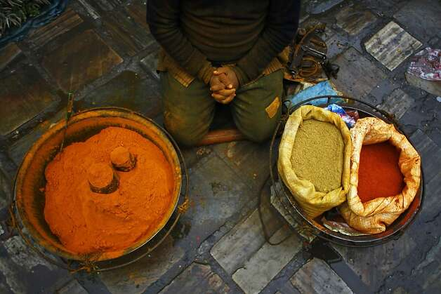 Have a whiff: A Nepalese spice vendor waits for customers at the Ason market in Katmandu. Photo: Niranjan Shrestha, Associated Press