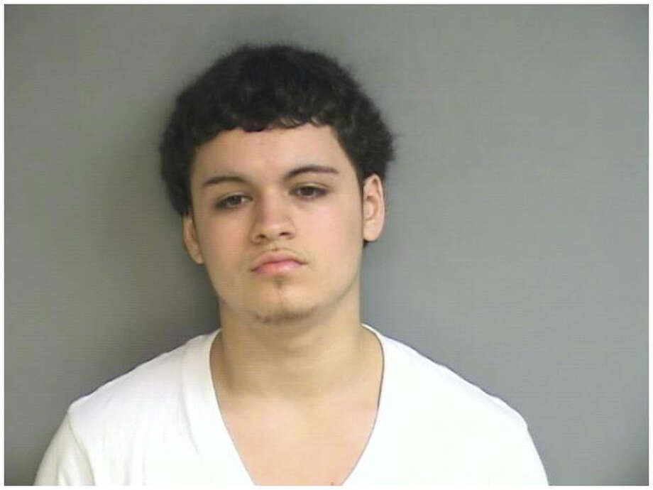 Ricardo Correa, 21, of 206 Cove Road., was charged Tuesday with possession of narcotics, possession of narcotics with intent to sell, operating a drug factory, possession of marijuana and possession of marijuana with intent to sell. Photo: Contributed Photo