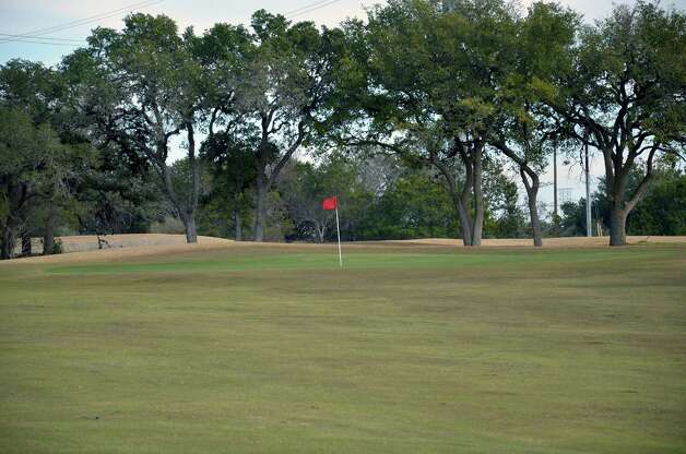 Trees sit behind the No. 15 green at the Buckhorn in Comfort. Photo: LeAnna Kosub
