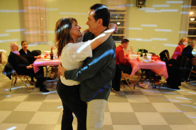 Betty and Bill Piacitelli, of Monroe, slow dance during the Second Annual Valentine Dance which was held at the Knights of Columbus Tinto Council #47 in Milford, Conn. on Saturday February 2, 2013. The council is one of the oldest in the Roman Catholic fraternal organization and will be celebrating its 125th anniversary. Photo: Christian Abraham / Connecticut Post