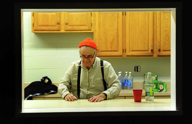 Knights of Columbus member Frank Elliot Jr. mans the drink counter during the Second Annual Valentine Dance which was held at the Knights of Columbus Tinto Council #47 in Milford, Conn. on Saturday February 2, 2013. The council is one of the oldest in the Roman Catholic fraternal organization and will be celebrating its 125th anniversary. Photo: Christian Abraham / Connecticut Post
