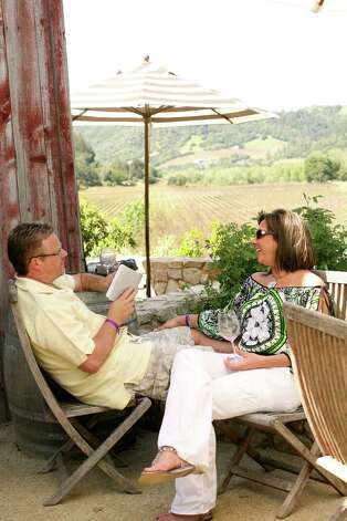 Visitors sip wine and relax with the Dry Creek Valley vineyards for a backdrop. Photo: Winegrowers Of Dry Creek Valley