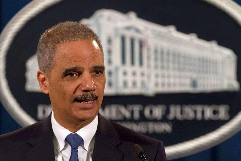 Charges against Standard & Poor's announced by Attorney General Eric Holder are the first filed against a credit rating firm over the mortgage crisis. Photo: Jacquelyn Martin, STF / AP