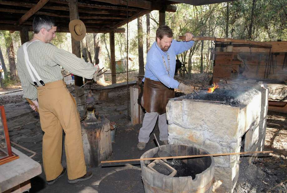 Phillip Ellison of Spring, left, and Larry Hoff of Cy-Fair work as blacksmiths at a past Homestead Heritage Day at Jesse H. Jones Park & Nature Center. Photo: Thomas Nguyen, Freelance / Freelance