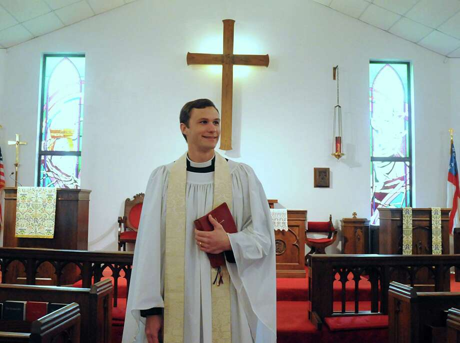 "The Rev. Jimmy Abbott welcomes parishioners at Holy Comforter Episcopal Church. Abbott will be leading ""drive-thru"" ceremonies on Ash Wednesday. The young priest says he is looking for ways to remind the community that God loves them and cares for them. Photo: David Hopper, Freelance / freelance"