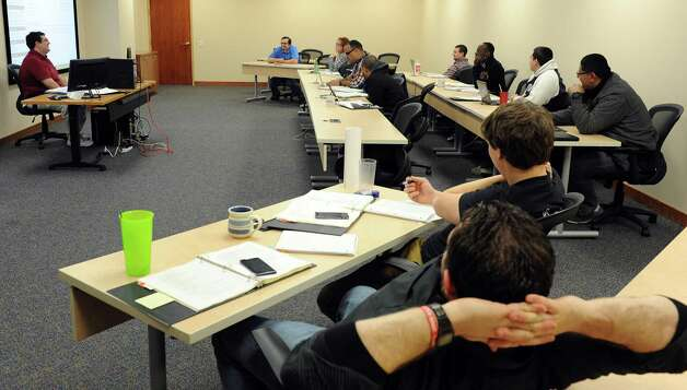 New hires are trained in Datto's Norwalk office on Tuesday, February 5, 2013. Photo: Lindsay Perry / Stamford Advocate