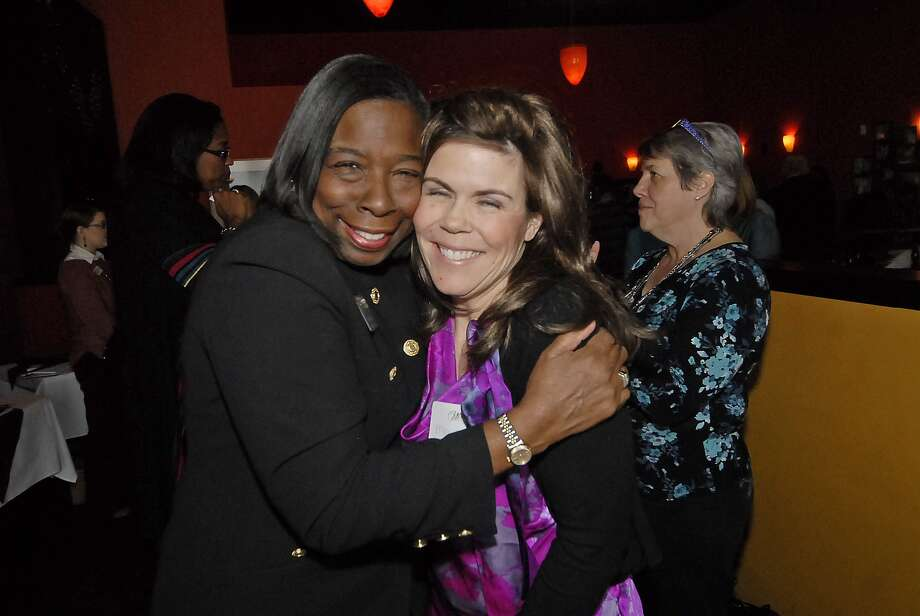 Carolyn Gray, left, and Michelle Brooks greet each other during one of the twice-monthly Women On A Mission To Earn A Commission meetings held at Mezzanotte Ristorante in Cypress. Photo:  Tony Bullard 2012, Freelance Photographer / © Tony Bullard & the Houston Chronicle