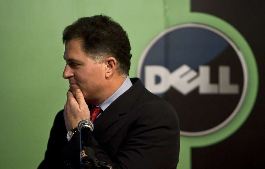FILE - In this Thursday, March 26, 2009, file photo, Michael Dell, Chairman and CEO of Dell Inc., reacts to a question during a press conference in Beijing, China.  Slumping personal computer maker Dell announced Tuesday, Feb. 5, 2013, it is bowing out of the stock market in a $24.4 billion buyout that represents the largest deal of its kind since the Great Recession dried up the financing for such risky maneuvers. billion. Michael Dell, who owns nearly 16 percent stake in the company, will remain the CEO after the sale closes and will contribute his existing stake in Dell to the new company. (AP Photo/Alexander F. Yuan, File) Photo: Alexander F. Yuan, Associated Press