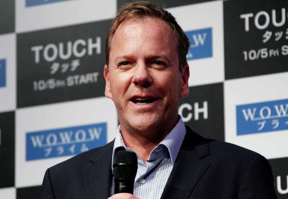 "FILE - In a Monday, Sept. 3, 2012 file photo, actor Kiefer Sutherland speaks during a press conference on his TV drama ""Touch"" in Tokyo. Sutherland has been named Man of the Year by Harvard University's Hasty Pudding Theatricals. Sutherland will be roasted and receive his ceremonial pudding pot at a ceremony scheduled for Friday, Feb. 8, 2013. (AP Photo/Koji Sasahara, File) Photo: Koji Sasahara"