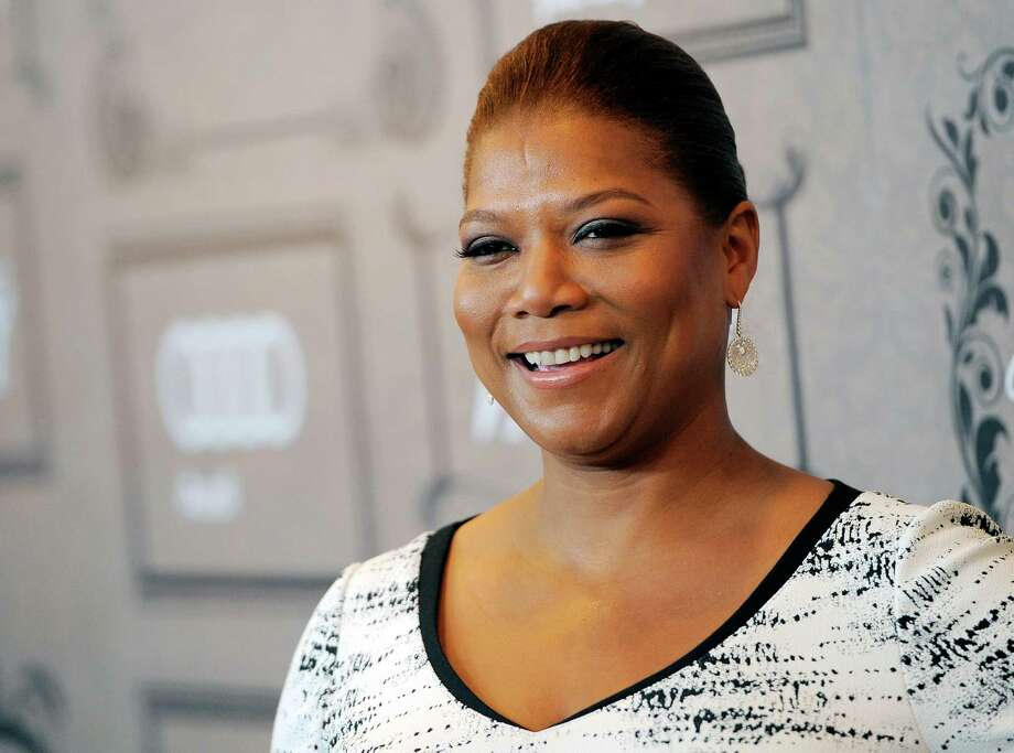 "FILE - This Oct. 5, 2012 file photo shows Queen Latifah at Variety's 4th annual Power of Women event in Beverly Hills, Calif.  Queen Latifah's production company, Flavor Unit Entertainment, has signed a deal with Netflix. The entertainer announced Tuesday, Feb. 5, 2013, that the multiyear deal gives the streaming service first look at titles from her production company. Latifah launched Flavor Unit in New Jersey with Shakim Compere. It's now based in Miami. The company has produced films such as ""Bringing Down the House"" and ""Just Wright,"" both starring Latifah. (Photo by Chris Pizzello/Invision/AP, file) Photo: Chris Pizzello"