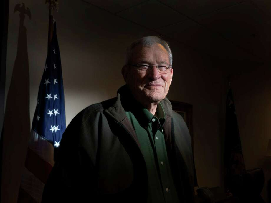 Ed Whitacre, who is being honored on February 15 as an inductee into the San Antonio Sports Hall of Fame, stands in his office on Wednesday, Jan. 16, 2013. Photo: Billy Calzada, San Antonio Express-News / SAN ANTONIO EXPRESS-NEWS