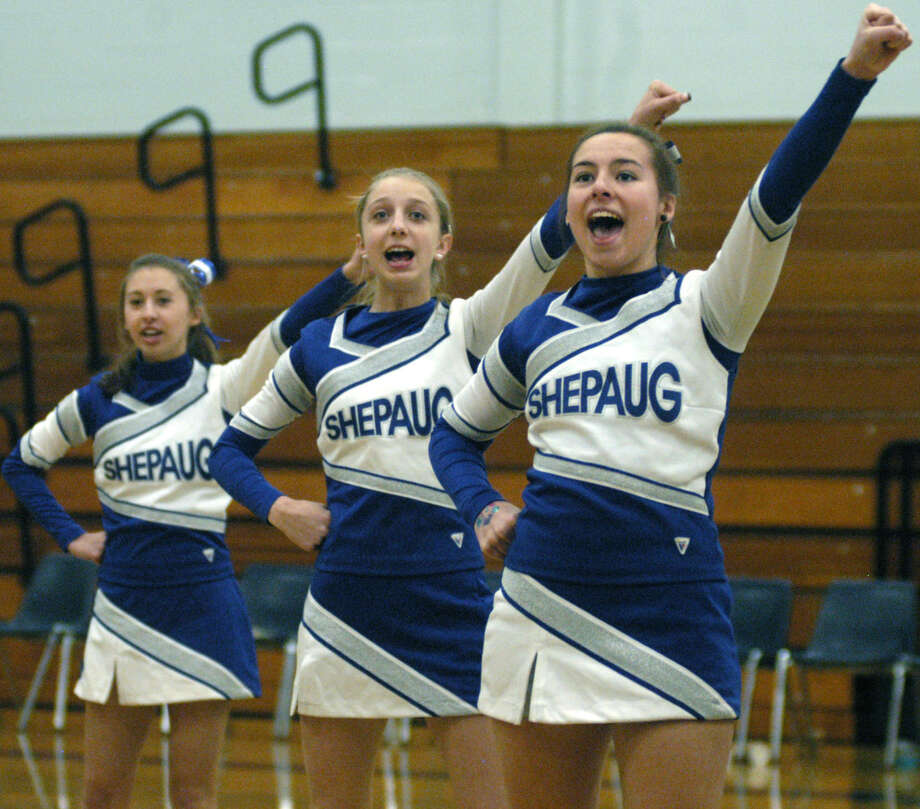 Go, Spartans!  Shepaug Valley High cheerleaders, above, from left to right, Emma DelVecchio, Kaitlyn Smith and Bria Noone, fire up the crowd at Shepaug Valley High School boys' basketball's game vs. Gilbert, Jan. 18, 2013 in Washington. The girls lend vocal and emotional support to the Spartan boys' and girls' basketball teams during their home games. Contributing their talents are, right photo, from left to right, front row, Kayley Bresson, Bria Noone and Claire Caco; back row, Emma DelVecchio, Kaitlyn Smith and Lyndsey DelVecchio. Photo: Norm Cummings