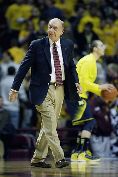 ESPN college basketball broadcaster Dick Vitale walks the court before an NCAA basketball game betwe
