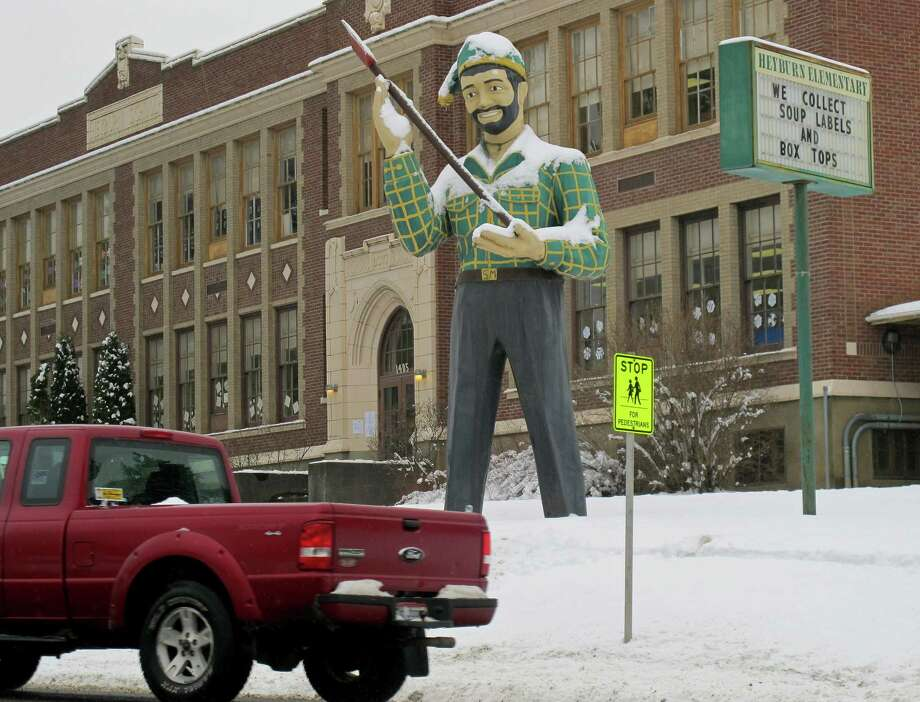 In this photo taken last month, a statue of a logger stands outside an elementary school in St. Maries, Idaho, near where a survivalist group plans to build a compound. Photo: Nicholas K. Geranios, STF / AP