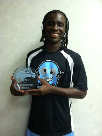 Ozen football player Tony Brown holds his MVP trophy he won as the top defensive back at the Rivals100 Underclassmen Challenge last weekend in Desoto. Photo taken July 9, 2012. Photo: Jared Ainsworth