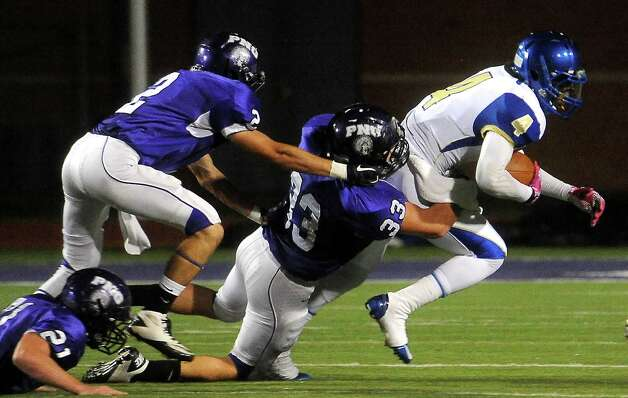 Ozen's Tony Brown is persued by a host of PN-G defenders at Port Neches-Groves High School in Port Neches, Friday, October 14, 2011. Tammy McKinley/The Enterprise Photo: TAMMY MCKINLEY