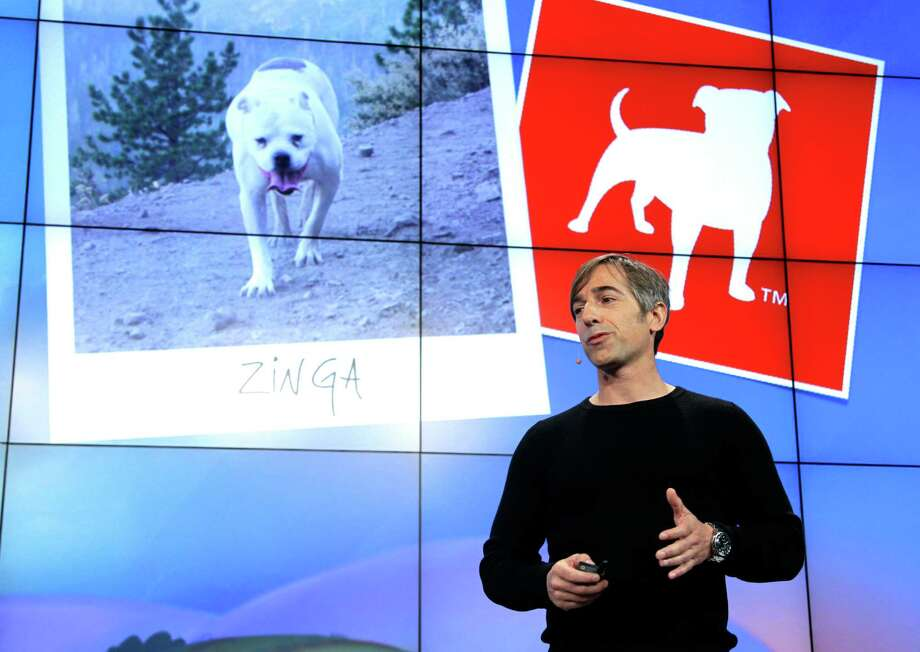 FILE - In this Tuesday, June 26, 2012, file photo, Zynga CEO Mark Pincus talks about the Zynga logo during an announcement at Zynga headquarters in San Francisco. Online game maker Zynga reported on Tuesday, Feb. 5, 2013,  a smaller net loss and nearly flat revenue for the fourth quarter of 2012, a year in which its stock price shrank 75 percent. (AP Photo/Paul Sakuma) Photo: Paul Sakuma, STF / AP