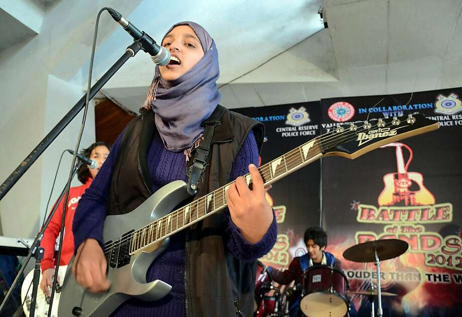 The group Pragaash performs at its only concert, in Srinagar, India, in December, before Muslim hard-liners forced them to disband. Photo: Str, AFP/Getty Images