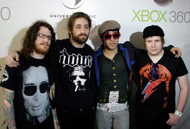 Members of American rock band Fall Out Boy from right to left, Patrick Stump, Pete Wentz, Joe Trohman and Andy Hurley arrive for a  performance onboard the Australian Warship HMAS Tobruk  in  Sydney, Australia, Sunday, Feb. 22, 2009. (AP Photo/Rob Griffith) Photo: Rob Griffith, STF / AP