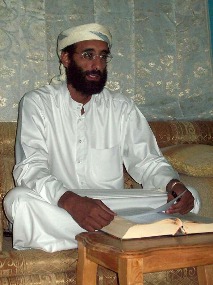 FILE - This Oct. 2008 file photo shows Imam Anwar al-Awlaki in Yemen. Al-Awlaki was born in 1971 in New Mexico where his father was studying agriculture as a Fulbright scholar. The son was educated in the United States but left in 2002, eventually returning to Yemen where he became a key figure in the local al-Qaida branch, which U.S. authorities believed was the most dangerous of the al-Qaida franchises. Al-Awlaki's fluent English and articulate speaking style won him a huge following among disaffected young Muslims in the West. He and another American, Samir Khan, who edited al-Qaida's Internet magazine, were killed in a U.S. drone attack in Yemen on Sept. 30, 2011. (AP Photo/Muhammad ud-Deen, File) Photo: Anonymous, Associated Press