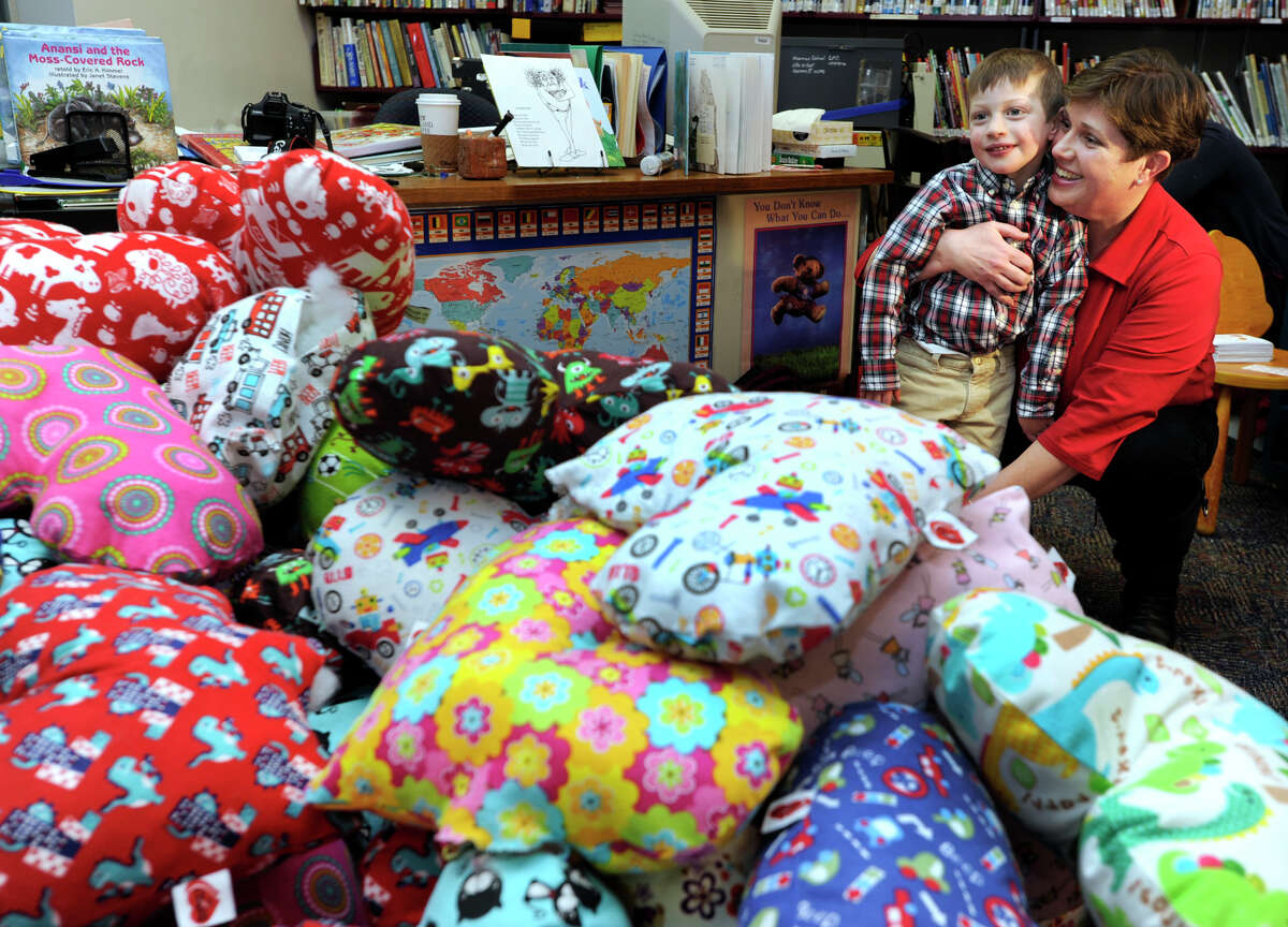 Marie Hatcher and her son Matthew look at some of the pillows that were made for the second annual