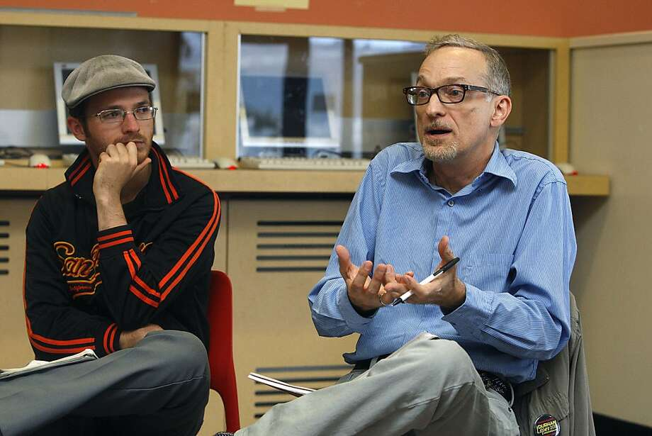 Student Eric Blanc (left) listens to chemistry teacher Bob Price at a meeting of the Save City College Coalition in October. Photo: Liz Hafalia, The Chronicle
