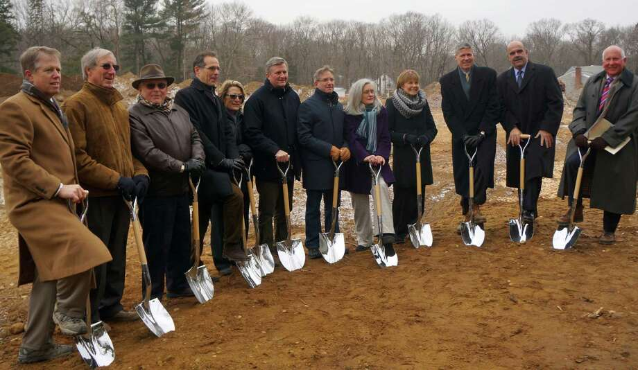 Officials gather Tuesday for the ceremonial grounbreaking on construction of the Westport Weston Family Y's on its Mahackeno campus.  WESTPORT NEWS, CT 2/5/13 Photo: Paul Schott / Westport News