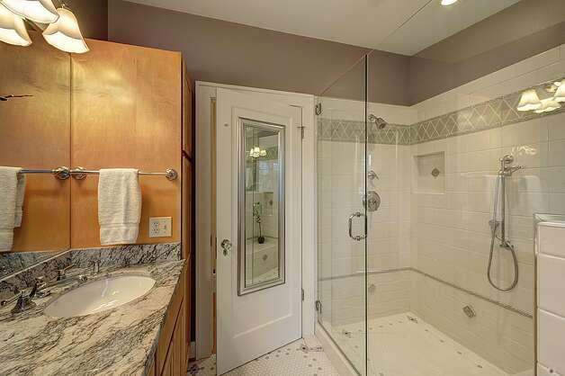 Master three-quarter bathroom of 4725 51st Ave. S. The 2,130-square-foot house, built in 1928, has four bedrooms, 1.75 bathrooms, an office, coved ceilings and a big back deck on a 4,800-square-foot lot. It's listed for $520,000. Photo: Jason Mercio/Courtesy Fionnuala O'Sullivan/Gerrard Beattie & Knapp
