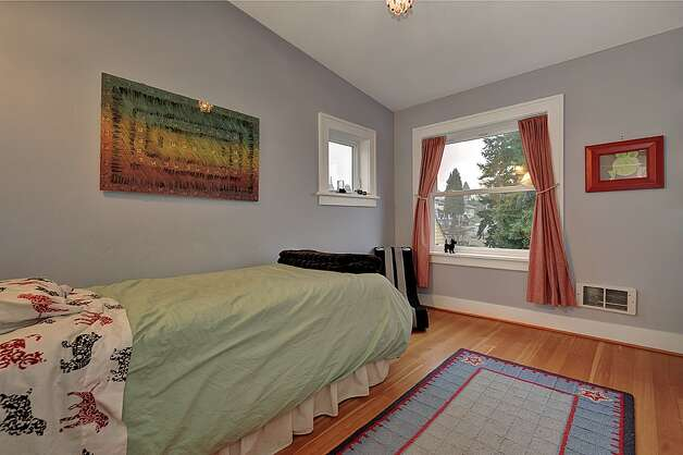 Bedroom of 4725 51st Ave. S. The 2,130-square-foot house, built in 1928, has four bedrooms and 1.75 bathrooms -- including a master suite with a vaulted ceiling -- an office, coved ceilings and a big back deck on a 4,800-square-foot lot. It's listed for $520,000. Photo: Jason Mercio/Courtesy Fionnuala O'Sullivan/Gerrard Beattie & Knapp