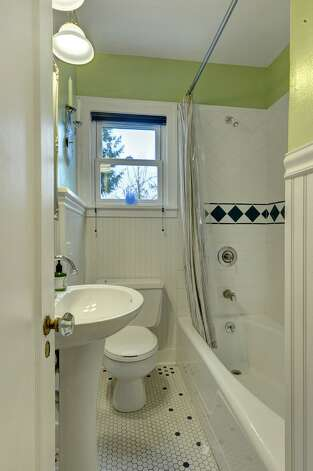 Bathroom of 4725 51st Ave. S. The 2,130-square-foot house, built in 1928, has four bedrooms and 1.75 bathrooms -- including a master suite with a vaulted ceiling -- an office, coved ceilings and a big back deck on a 4,800-square-foot lot. It's listed for $520,000. Photo: Jason Mercio/Courtesy Fionnuala O'Sullivan/Gerrard Beattie & Knapp