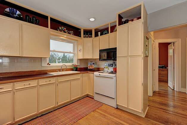 Kitchen of 4725 51st Ave. S. The 2,130-square-foot house, built in 1928, has four bedrooms and 1.75 bathrooms -- including a master suite with a vaulted ceiling -- an office, coved ceilings and a big back deck on a 4,800-square-foot lot. It's listed for $520,000. Photo: Jason Mercio/Courtesy Fionnuala O'Sullivan/Gerrard Beattie & Knapp