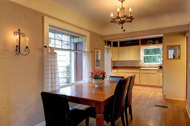 Dining room of 4725 51st Ave. S. The 2,130-square-foot house, built in 1928, has four bedrooms and 1.75 bathrooms -- including a master suite with a vaulted ceiling -- an office, coved ceilings and a big back deck on a 4,800-square-foot lot. It's listed for $520,000. Photo: Jason Mercio/Courtesy Fionnuala O'Sullivan/Gerrard Beattie & Knapp