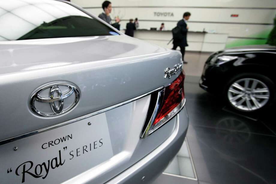 A Toyota Crown Royal is displayed at the company's headquarters in Tokyo. Profit is up 23 percent. Photo: Kiyoshi Ota / © 2013 Bloomberg Finance LP