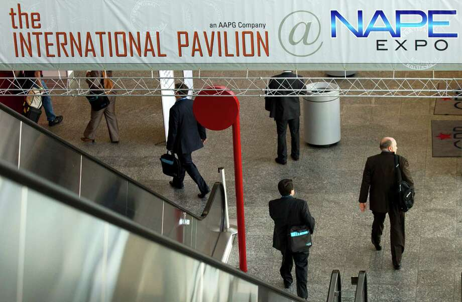 Delegates to the NAPE Winter Conference enter the International Pavilion at the George R. Brown Convention Center on Tuesday. About 18,000 people are expected this year, up slightly from last year. Photo: Brett Coomer, Houston Chronicle / © 2013 Houston Chronicle