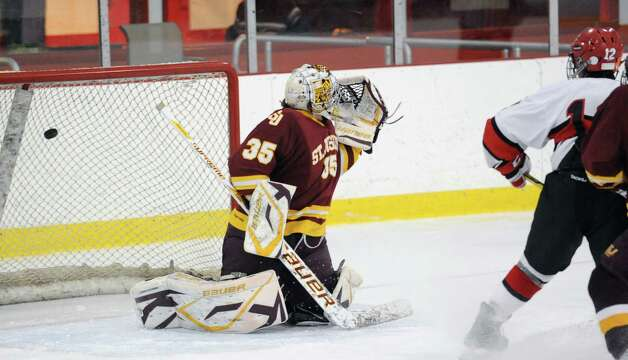 St. Joseph goalie Marc Van Etten # 35 looks over his shoulder as a shot by Matt Lodato of Greenwich finds the net for a goal during the second period of the boys high school ice hockey game between St. Joseph High School and Greenwich High School at Hamill Rink in Byram, Tuesday night, Feb. 5, 2013. At right is Billy Lewis # 12 of Greenwich. St. Joseph defeated Greenwich, 5-2. Photo: Bob Luckey / Greenwich Time