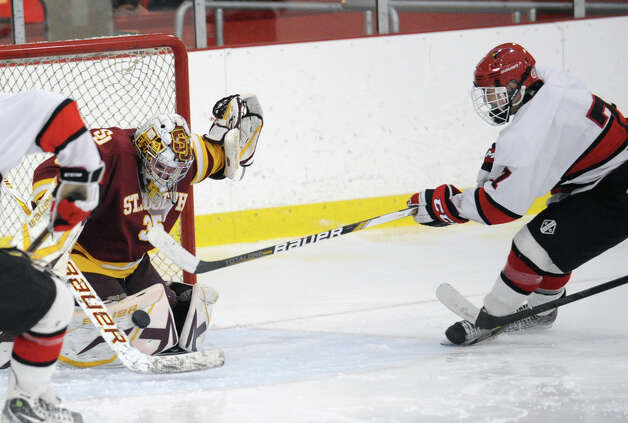 Brian Silard # 7 of Greenwich gets a point-blank shot blocked by St. Joseph goalie Marc Van Etten # 35 during the boys high school ice hockey game between St. Joseph High School and Greenwich High School at Hamill Rink in Byram, Tuesday night, Feb. 5, 2013. St. Joseph defeated Greenwich, 5-2. Photo: Bob Luckey / Greenwich Time