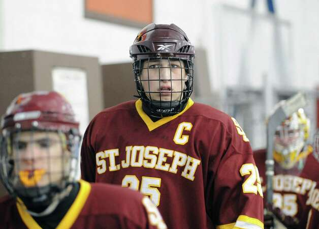 Andrew Gore # 25 of St. Joseph leads his team onto the ice during the boys high school ice hockey game between St. Joseph High School and Greenwich High School at Hamill Rink in Byram, Tuesday night, Feb. 5, 2013. St. Joseph defeated Greenwich, 5-2. Photo: Bob Luckey / Greenwich Time